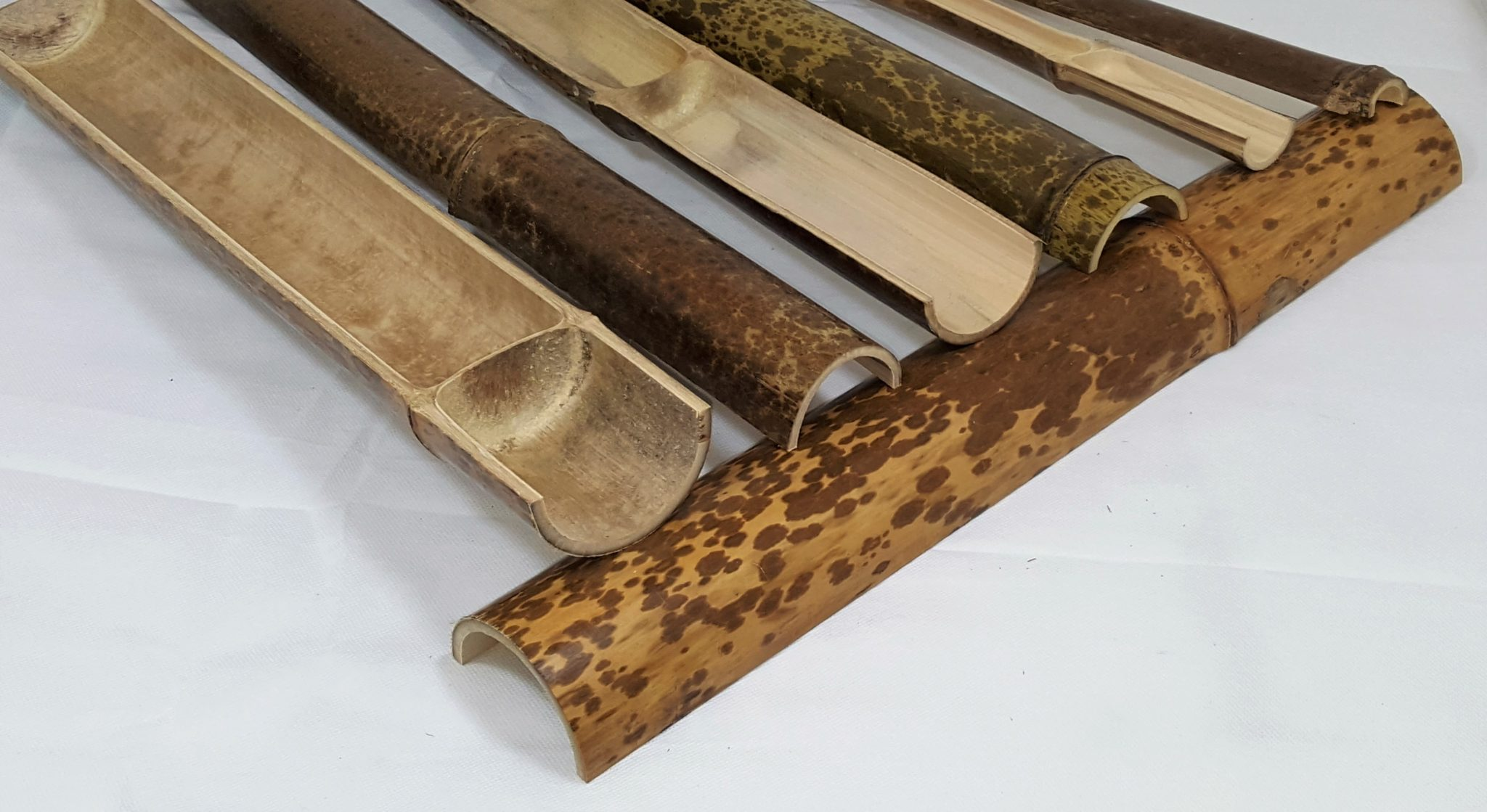 Split Natural Speckled Bamboo Poles Half Pole on Cane And Bamboo Furniture