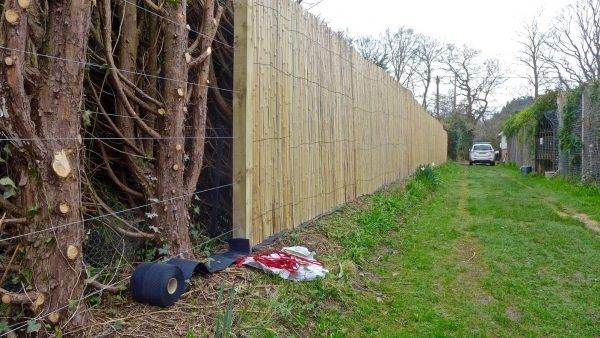 The fencing being installed using tension wires.