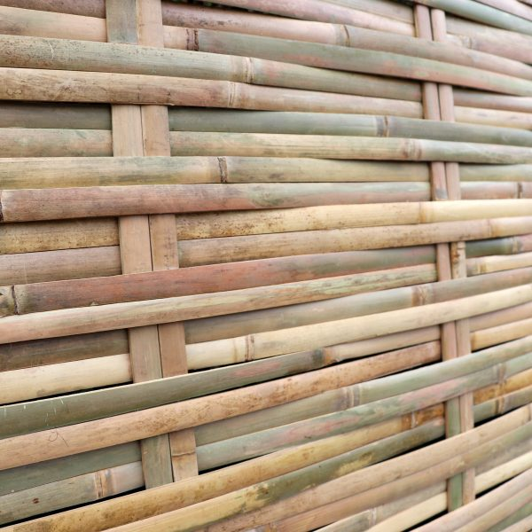 close-up shot of tali woven bamboo fence side view